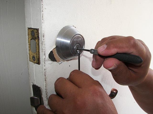Man picking lock using tools