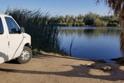 Parked Bug Out Vehicle Next To A Lake